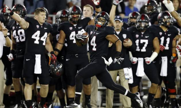 Stanford's Drew Terrell runs down the sideline on a 76-yard punt return for a touchdown against Duke during the first half of an NCAA college football game in Stanford, Calif., Saturday, Sept. 8, 2012. (AP Photo/Marcio Jose Sanchez)