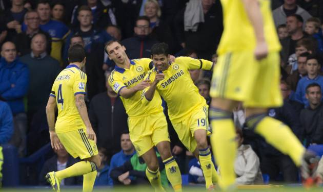 Chelsea's Diefo Costa, centre right, celebrates with teammates after scoring against Everton during their English Premier League soccer match at Goodison Park Stadium, Liverpool, England, Saturday Aug. 30, 2014. (AP Photo/Jon Super)