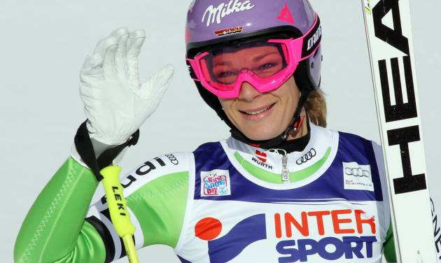Germany's Maria Hoefl-Riesch celebrates her second place after completing an alpine ski, women's World Cup super-g,, in Cortina d'Ampezzo, Italy, Thursday, Jan. 23, 2014. (AP Photo/Armando Trovati)