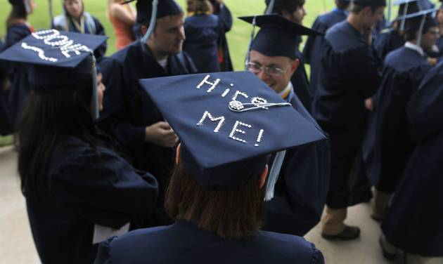 "Jeanna Wilson, an Elementary Education major, wears a cap that says, ""Hire Me!"" before a University of Central Oklahoma graduation ceremony in Edmond, Friday, May 4.  Photo by Garett Fisbeck, For The Oklahoman"