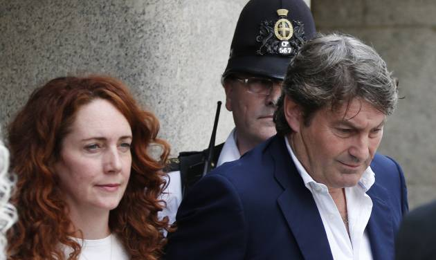 Rebekah Brooks, former News International chief executive, left, accompanied by her husband Charlie Brooks, leaves the Central Criminal Court in London, Tuesday, June 24, 2014. Former News of the World editor Andy Coulson was convicted of phone hacking Tuesday, but fellow editor Rebekah Brooks was acquitted after a months-long trial centering on illegal activity at the heart of Rupert Murdoch's newspaper empire. A jury at London's Old Bailey unanimously found Coulson, the former spin doctor of British Prime Minister David Cameron, guilty of conspiring to intercept communications. Brooks was acquitted of that charge and of counts of bribing officials and obstructing police. The nearly eight-month trial was triggered by revelations that for years the News of the World used illegal eavesdropping to get stories, listening in on the voicemails of celebrities, politicians and even crime victims. (AP Photo/Lefteris Pitarakis)