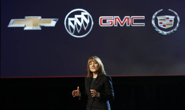FILE - In this Sunday, Jan. 12, 2014, file photo, incoming General Motors CEO Mary Barra introduces the 2015 GMC Canyon at media previews for the North American International Auto Show, in Detroit. General Motors Co. said Tuesda, Jan. 14, 2014 that it will resume paying a quarterly dividend for the first time in nearly six years and named a new CFO.  (AP Photo/Paul Sancya, File)
