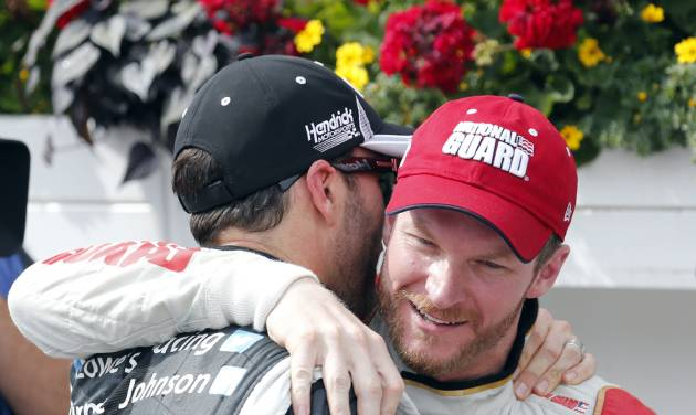 Jimmie Johnson, left, congratulates Dale Earnhardt Jr. after Earnhardt won the NASCAR Sprint Cup Series Pocono 400 auto race at Pocono Raceway on Sunday, June 8, 2014, in Long Pond, Pa. (AP Photo/Mike Groll)