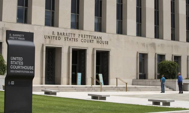 A view of the E. Barrett Prettyman Federal Courthouse that houses the U.S. Court of Appeals for the D.C. Circuit, on Tuesday, July 22, 2014, in Washington. Obama's health care law is enmeshed in another big legal battle after two federal appeals courts issued contradictory rulings on a key financing issue within hours of each other Tuesday.   (AP Photo/ Evan Vucci)
