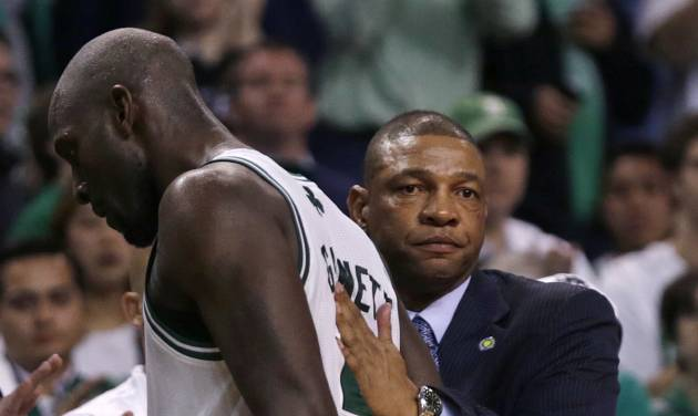 Boston Celtics head coach Doc Rivers, right, gives forward Kevin Garnett a pat on the back after taking him out of the game in the final minute during the second half in Game 6 of their first-round NBA basketball playoff series against the New York Knicks in Boston, Friday, May 3, 2013. The Knicks won 88-80, eliminating the Celtics from the playoffs. (AP Photo/Charles Krupa)