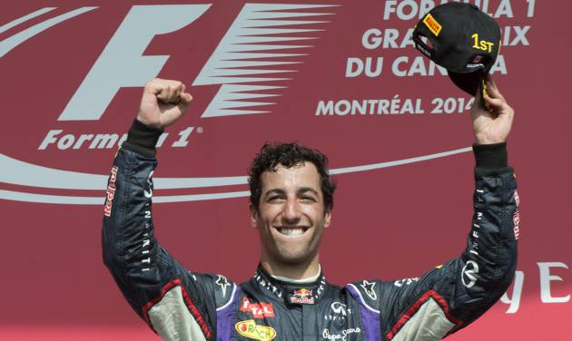 Red Bull driver Daniel Ricciardo from Australia celebrates his victory at the Canadian Grand Prix, Sunday, June 8, 2014 in Montreal. (AP Photo/The Canadian Press, Paul Chiasson)