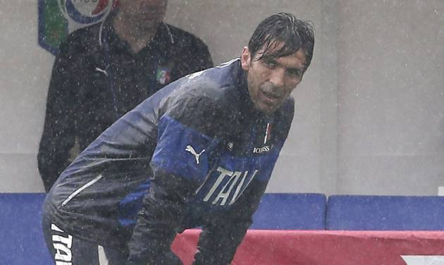Italy goalkeeper Gianluigi Buffon stands on the pitch during a rain shower during a training session in Mangaratiba, Brazil, Tuesday, June 10, 2014. Italy will play in group D of the Brazil 2014 soccer World Cup. (AP Photo/Antonio Calanni)