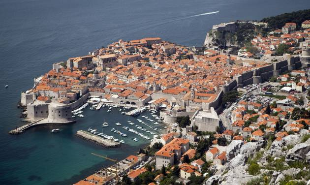 WITH STORY CROATIA GOLF REFERENDUM - Dubrovnik old town is pictured from Srdj, the hill above the city, Friday, April 26, 2013. The residents of this scenic Croatian Adriatic sea resort will decide hold a referendum on Sunday April 28, 2013, whether to allow the 1.1-billion euros ($1.4 billion) golf park development project on the hill above the city that many claim endangers their ancient city, often dubbed the Pearl of the Adriatic, and the outcome could have serious consequences on the future of foreign investments in Croatia. (AP Photo/Darko Bandic)