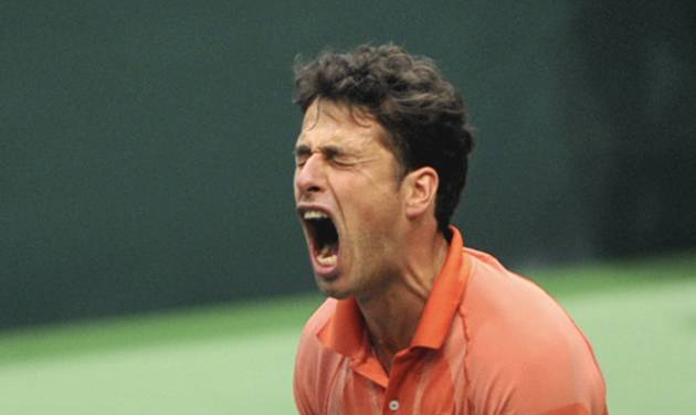 Robin Haase from the Netherlands celebrates after he defeated Radek Stepanek from the Czech Republic in their opening single of the tennis Davis Cup first round match in Ostrava, Friday, Jan. 31, 2014. Haase won 3-6, 6-4, 6-7, 6-2 ,1-6.  (AP Photo,CTK/Jaroslav Ozana) SLOVAKIA OUT