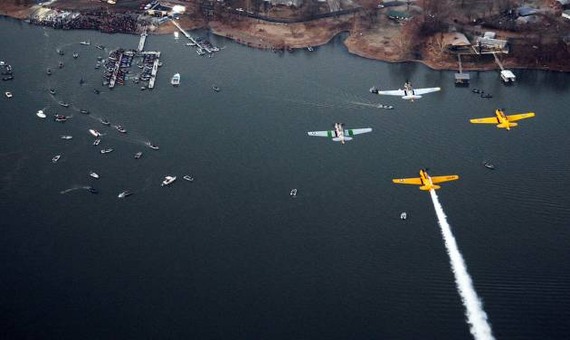 A formation of T-6 aircraft fly over during the playing of the national anthem during the Bassmaster Classic on Grand Lake on Saturday, Feb. 23, 2013, in Tulsa. PHOTO BY TOM GILBERT, TULSA WORLD