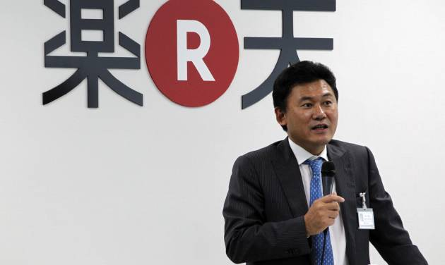 FILE  - In this Oct. 3, 2011 photo, Rakuten Inc.,Chief Executive Hiroshi Mikitani gives a pep talk in English, the standard language at Rakuten, at a welcoming ceremony for new hires at its headquarters in Tokyo. Rakuten is buying Cyprus-based Viber Media, which operates a popular Internet phone application, for $900 million, fortifying the online retailer's social networking footprint. (AP Photo/Koji Sasahara, File)
