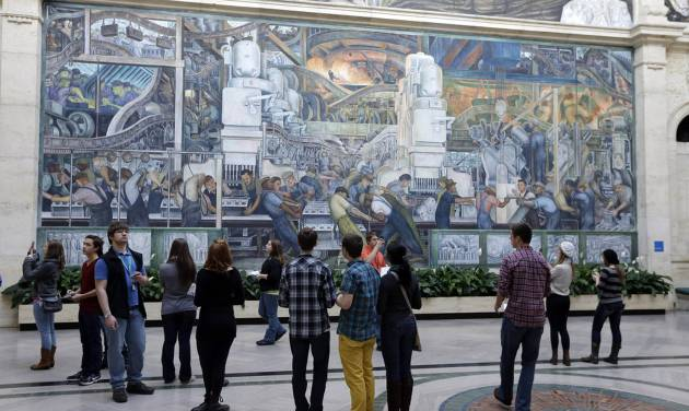 FILE - In this Dec. 10, 2013 file photo, visitors look at the Detroit Industry Murals by the Diego Rivera at the Detroit Institute of Arts in Detroit. Michigan Gov. Rick Snyder is floating to lawmakers whether the state should contribute money to shore up Detroit pension plans to stave off the sale of city-owned pieces in an art museum.  (AP Photo/Carlos Osorio, File)