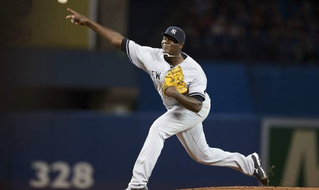 New York Yankees starting pitcher Michael Pineda delivers a pitch during the third inning of a baseball game in Toronto on Saturday, April 5, 2014. (AP Photo/The Canadian Press, Peter Power)