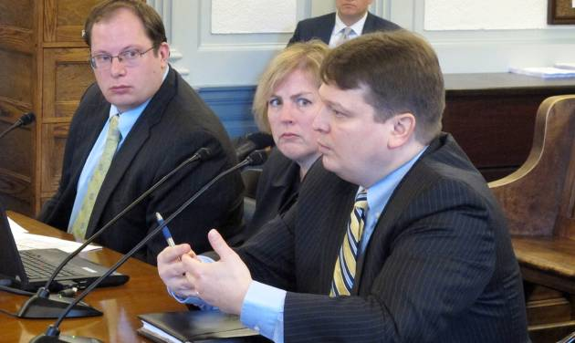 State Natural Resources Commissioner Joe Balash, foreground, addresses the Senate Finance Committee during an overview of plans to advance a liquefied natural gas project on Monday, Jan. 27, 2014, in Juneau, Alaska. Pictured alongside Balash are, from left, Mike Pawlowski, a deputy Revenue commissioner, and Revenue Commissioner Angela Rodell, center. Shown in the background is Sen. Bill Wielechowski, D-Anchorage, one of several legislators who sat in on the presentation. (AP Photo/Becky Bohrer)