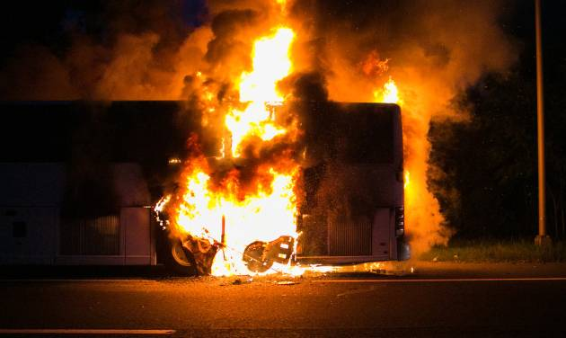 In this photo provided by James Kastner, a tour bus caught fire on a busy stretch of New Jersey highway, but no passengers were injured in Bridgewater, N.J., Saturday, July 19, 2014. State Police Sgt. Brian Polite says the fire was reported at about 8:40 p.m. Initial reports say passengers were seen running along the southbound lanes of Interstate 287, away from the blaze. There's no word yet on what caused the fire. (AP Photo/Jimmy Kastner) MANDATORY CREDIT