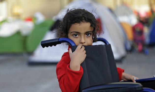 A child looks out at Athens port of Piraeus, Monday, April 4, 2016, during the first day of the implementation of the deal between EU and Turkey. Under the deal, migrants arriving illegally in Greece will be returned to Turkey if they do not apply for asylum or if they make an asylum claim that is rejected. (AP Photo/Lefteris Pitarakis)