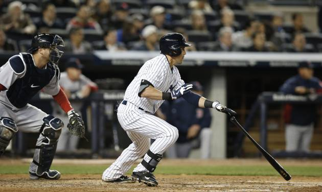 New York Yankees' Jacoby Ellsbury, right, hits a fifth-inning RBI-double in a baseball game against the Boston Red Sox at Yankee Stadium in New York, Thursday, April 10, 2014. (AP Photo/Kathy Willens)