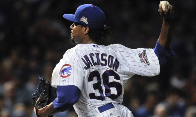 Chicago Cubs starting pitcher Edwin Jackson delivers in the first inning of a baseball game against the San Francisco Giants on Wednesday, August 20, 2014, in Chicago. (AP Photo/Matt Marton)