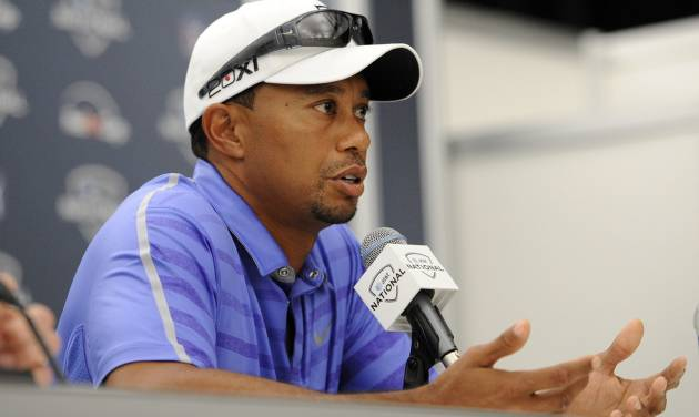 Tiger Woods speaks at a press conference at the AT&T National Golf tournament, Wednesday, July 26, 2013, in Bethesda, Md. Woods will not play in the tournament. (AP Photo/Nick Wass)