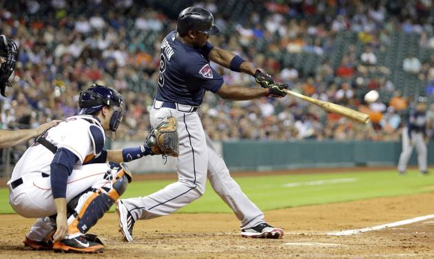 Atlanta Braves' Justin Upton (8) hits a home run in front of Houston Astros catcher Jason Castro during the fourth inning of a baseball game Tuesday, June 24, 2014, in Houston. (AP Photo/David J. Phillip)