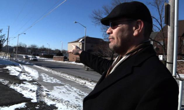 In this image from a Jan. 29, 2014 video, Ricardo Nieves stands in a parking lot where he says he was stopped and motions in the direction he says he'dbeendriving from during the National Roadside Survey of Alcohol and Drugged Driving on Dec. 13, 2013 in Reading, Pa. Nieves filed a federal lawsuit over the survey, saying his rights were violated when a government contractor forced him into the parking lot, where he was questioned about his driving habits and asked to provide a saliva sample. (AP Photo/Michael Rubinkam)