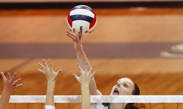 Santa Fe's Jordan Spence returns a ball on the front line against Stillwater's Kaitlyn  Cotton in first round action during Stillwater vs. Edmond Santa Fe game in Class 6A volleyball tournament at Shawnee High School on Friday, Oct. 12, 2012.   Photo by Jim Beckel, The Oklahoman