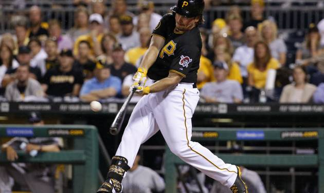 Pittsburgh Pirates' Travis Snider drives in the go-ahead run with a double off Colorado Rockies relief pitcher Matt Belisle during the eighth inning of a baseball game in Pittsburgh on Friday, July 18, 2014. The Pirates won 4-2. (AP Photo/Gene J. Puskar)