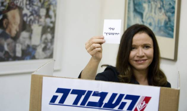 FILE - In this Monday, Sept. 12, 2011 file photo, Israel's Labor party candidate and former journalist Shelly Yachimovich holds a ballot with her name before casting her vote in Tel Aviv, Israel. Israel's Labor Party will be fielding a large number of former journalists in the country's upcoming parliamentary elections. Six former journalists, including party chairwoman Shelly Yachimovich, figure among the top 25 labor candidates who will be running in the Jan. 22 parliamentary race. The party held its primary on Thursday and released the list of candidates on Friday. (AP Photo/Ariel Schalit, File)