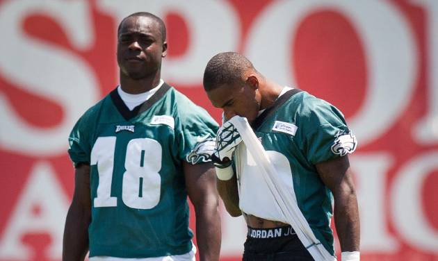 Philadelphia Eagles wide receiver DeSean Jackson, right, and Jeremy Maclin take a break between drills at NFL football training camp in Philadelphia, Friday, July 26, 2013. (AP Photo/The News Journal, Suchat Pederson)  NO SALES