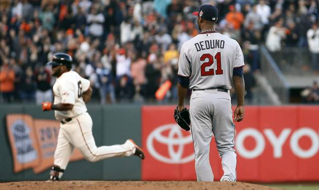 San Francisco Giants' Pablo Sandoval rounds the bases after his solo home run off Minnesota Twins starting pitcher Samuel Deduno (21) during the second inning in the second inning of a baseball game Saturday, May 24, 2014, in San Francisco. (AP Photo/Tony Avelar)