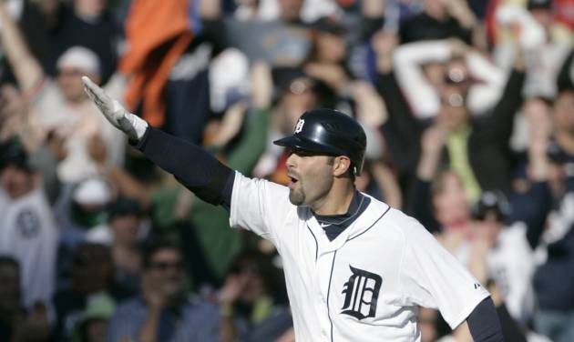 Detroit Tigers' Alex Avila celebrates his two-run walk-off home run that gave the Tigers a 13-12 win over the Boston Red Sox in the 11th inning of a baseball game Sunday, April 8, 2012, in Detroit. (AP Photo/Duane Burleson)