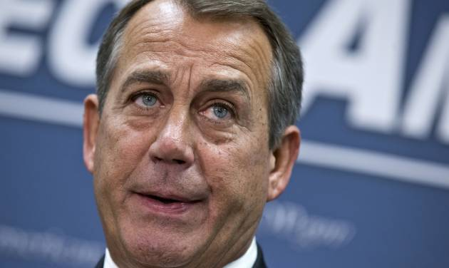 "House Speaker John Boehner of Ohio, who conferred with President Barack Obama by phone yesterday, speaks during a news conference on Capitol Hill in Washington, Wednesday, Dec. 12, 2012,  following a closed-door meeting with the GOP caucu. Boehner and the other House Republican leaders are calling for Obama to come up with plan they can accept for spending cuts and tax revenue to avoid the so-called ""fiscal cliff"" of automatic tax hikes and budget reductions. (AP Photo/J. Scott Applewhite)"