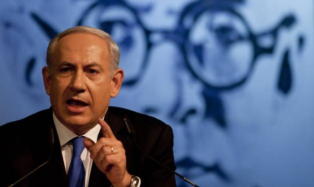 Israel's Prime Minister Benjamin Netanyahu delivers a speech to his Likud party members in Tel Aviv, Israel, Sunday, May 6, 2012. Prime Minister Benjamin Netanyahu is expected to announce Sunday night that he'll dissolve parliament to hold early elections, a move designed to fend off domestic critics and perhaps put him in a stronger position to act against Iran.(AP Photo/Ariel Schalit)