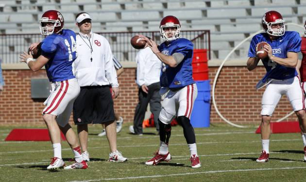 Quarterbacks Cody Thomas, Trevor Knight and Justice Hansen go through drills as the University of Oklahoma Sooners (OU) begin spring practice on Owen Field at Gaylord Family-Oklahoma Memorial Stadium in Norman, Okla., on Tuesday, March 11, 2014. Photo by Steve Sisney, The Oklahoman