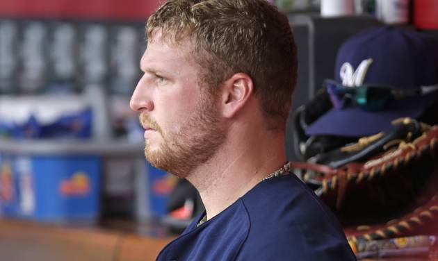 Milwaukee Brewers relief pitcher Will Smith sits in the dugout after they lost to the Cincinnati Reds 4-2 in a baseball game, Sunday, July 6, 2014, in Cincinnati. Smith was the losing pitcher, giving up a two-run home run to Jay Bruce in the eighth inning. (AP Photo/Al Behrman)