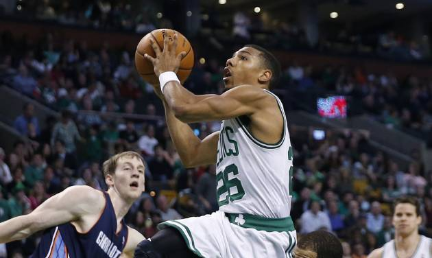 Boston Celtics' Phil Pressey (26) drives between Charlotte Bobcats' Cody Zeller (40) and Jannero Pargo (5) in the fourth quarter of an NBA basketball game in Boston, Friday, April 11, 2014. The Celtics won 106-103. (AP Photo/Michael Dwyer)