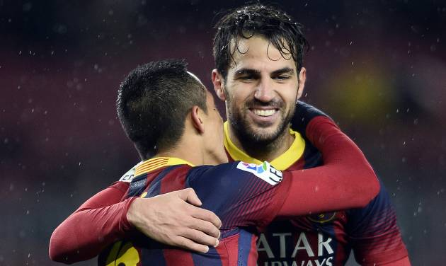 CORRECTS THE NAME OF BARCELONA'S OPPONENTS  FC Barcelona's Cesc Fabregas, right, celebrates with his teammate Alexis Sanchez, from Chile, after scoring against Levante during a Copa del Rey soccer match at the Camp Nou stadium in Barcelona, Spain, Wednesday, Jan. 29, 2014. (AP Photo/Manu Fernandez)