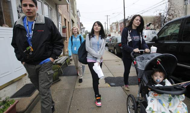 Charles Carroll High School student Samantha Pawlucy, center, arrives at the school Tuesday Oct. 9, 2012, with parents Richard, left, and mother Kristine, pushing son Matthew, in Philadelphia. Supporters of Pawlucy gathered outside the school to show support for the teen as she returned to school for the first time after she was allegedly mocked by her geometry teacher for wearing a Mitt Romney T-shirt last week. Her father said that Samantha, who never actually made it to class after the rally, and his other high-school age children will be transferring to another school. (AP Photo/Philadelphia Daily News, Alejandro A. Alvarez) THE EVENING BULLETIN OUT, TV OUT; MAGS OUT; NO SALES