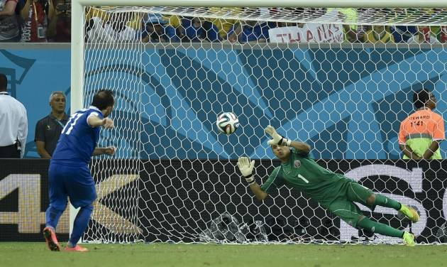 Costa Rica's goalkeeper Keylor Navas, right, makes a save on Greece's Fanis Gekas' penalty shot during a shootout after regulation time in the World Cup round of 16 soccer match between Costa Rica and Greece at the Arena Pernambuco in Recife, Brazil, Sunday, June 29, 2014. Costa Rica defeated Greece 5-3 in penalty shootouts after a 1-1 tie. (AP Photo/Martin Meissner)