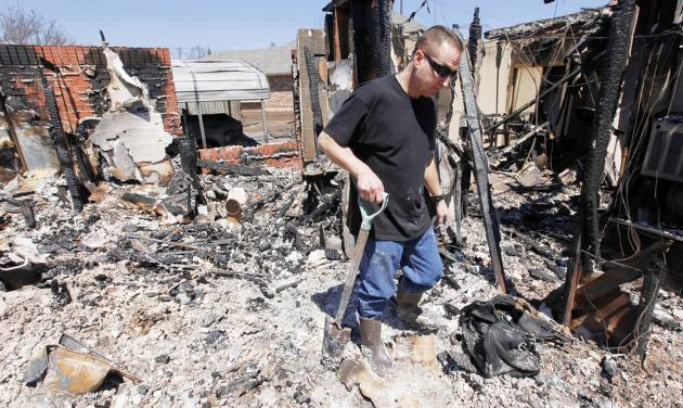 Todd Sewell walks through what is left of his Midwest City home, 11533 Berkshire Court, on Saturday. PHOTO BY NATE BILLINGS, THE OKLAHOMAN
