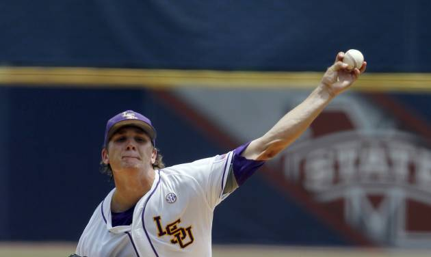 LSU's Kyle Bouman (28) pitches against Arkansas during the first inning at the Southeastern Conference NCAA college baseball tournament on Saturday, May 24, 2014, in Hoover, Ala. (AP Photo/Butch Dill)