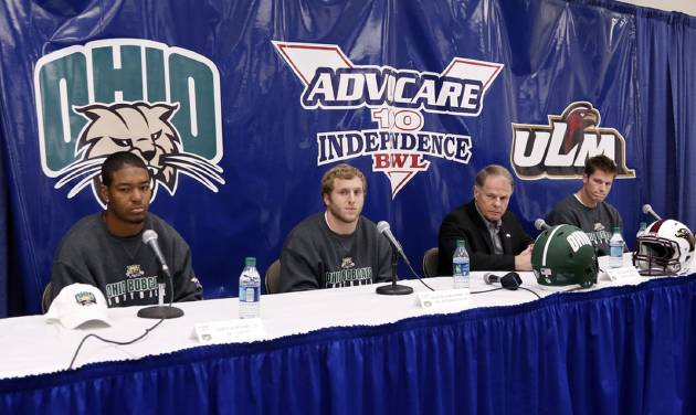 Ohio's safety Gerald Moore, left, running back Beau Blankenship, second from left,  and quarterback Tyler Tettleton, listen as coach Frank Solich, second from right, answers reporters questions during a NCAA college football news conference for the Independence Bowl, Thursday, Dec. 27, 2012, in Shreveport, La. Ohio is scheduled to play Louisiana-Monroe Friday. (AP Photo/Rogelio V. Solis) ORG XMIT: LARS106
