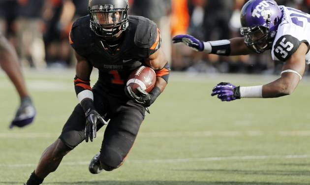 Oklahoma State's Joseph Randle, left, was a dependable cog on a banged-up OSU offense. The junior rushed for 1,351 yards and 14 touchdowns.  Photo by Nate Billings, The Oklahoman