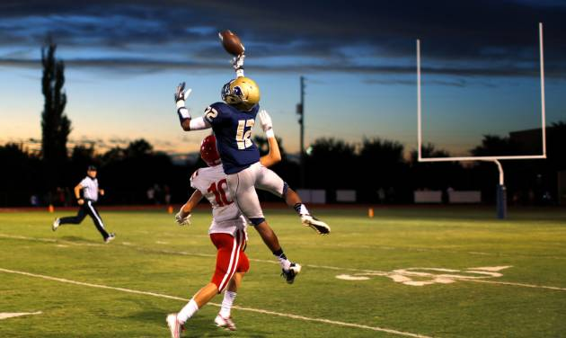 Heritage Hall's Domonique James leaps for a pass intended for Drew Melton of Davis during their high school football game in Oklahoma City, Friday, Sept. 20, 2013. Photo by Bryan Terry, The Oklahoman