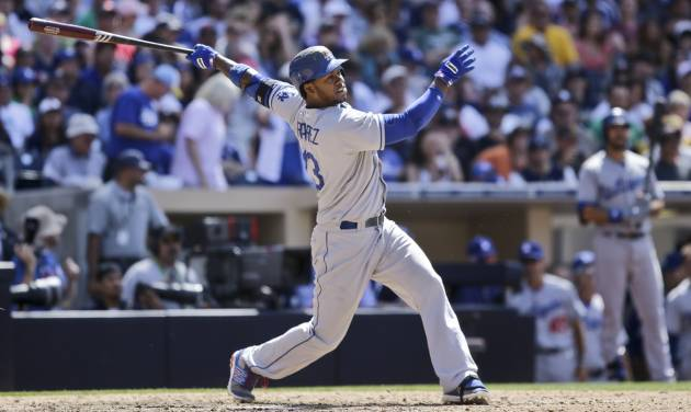 Los Angeles Dodgers' Hanley Ramirez watches his home run to right field against the San Diego Padres in the ninth inning of a baseball game won 3-1 by the Dodgers after they hit back-to-back home runs in San Diego, Sunday, June 23, 2013. (AP Photo/Lenny Ignelzi)