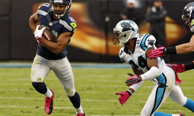 Seattle Seahawks' Golden Tate (81) runs past Carolina Panthers' Josh Norman (24) during the first quarter of an NFL football game in Charlotte, N.C., Sunday, Oct. 7, 2012. (AP Photo/Nell Redmond)