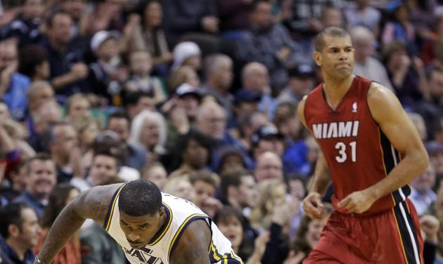 Utah Jazz's Marvin Williams (2) celebrates after hitting a 3-pointer while Miami Heat's Shane Battier (31) looks away during the first quarter of an NBA basketball game Saturday, Feb. 8, 2014, in Salt Lake City. (AP Photo/Rick Bowmer)