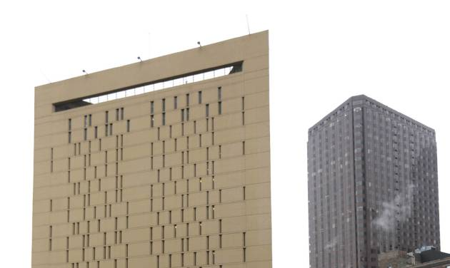 This photo shows the Metropolitan Correctional Center Tuesday, Dec. 18, 2012, in Chicago. Two convicted bank robbers used a knotted rope or bed sheets to escape from the federal prison window high above downtown Chicago early Tuesday, a week after one of them made a courtroom vow of retribution, to federal judge. The escape occurred sometime between 5 a.m. and 8:45 a.m. when the inmates were discovered missing, Chicago Police Sgt. Mark Lazarro said. Hours later, what appeared to be a rope, knotted at six-foot intervals, could be seen dangling into an alley from a window of the Metropolitan Correctional Center approximately 20 stories above the ground. (AP Photo/M. Spencer Green)