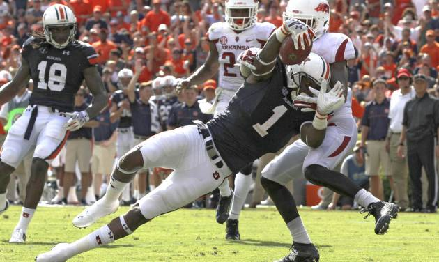 Auburn wide receiver D'haquille Williams (1) dives for the end zone for a touchdown as Arkansas cornerback Carroll Washington (21) tries to tackle him during the first half of an NCAA college football game on Saturday, Aug. 30, 2014, in Auburn, Ala. (AP Photo/Butch Dill)