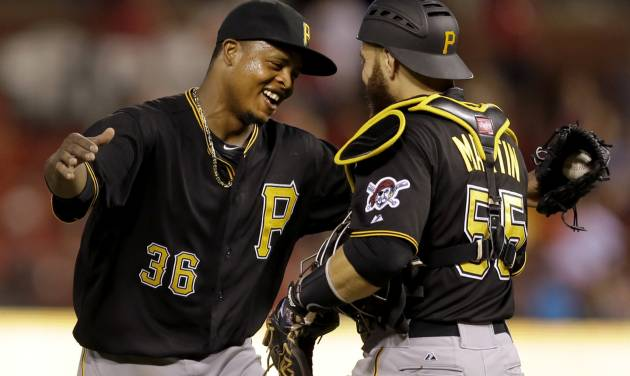 Pittsburgh Pirates starting pitcher Edinson Volquez, left, is congratulated by teammate Russell Martin after throwing a complete baseball game against the St. Louis Cardinals Thursday, July 10, 2014, in St. Louis. The Pirates won 9-1. (AP Photo/Jeff Roberson)